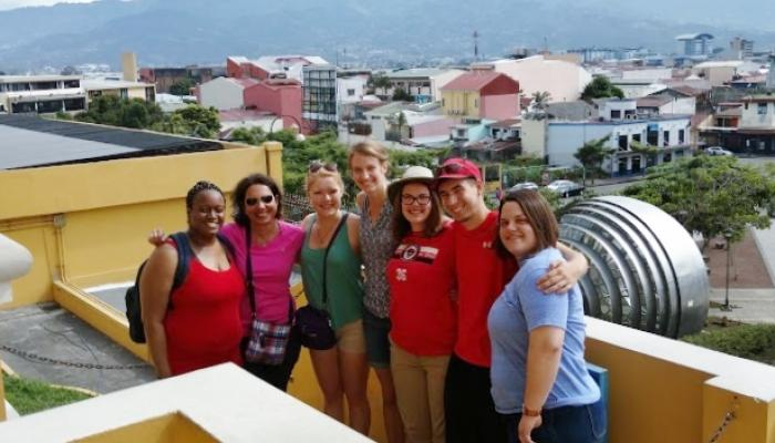 A group of Davenport students on a rooftop in Europe.